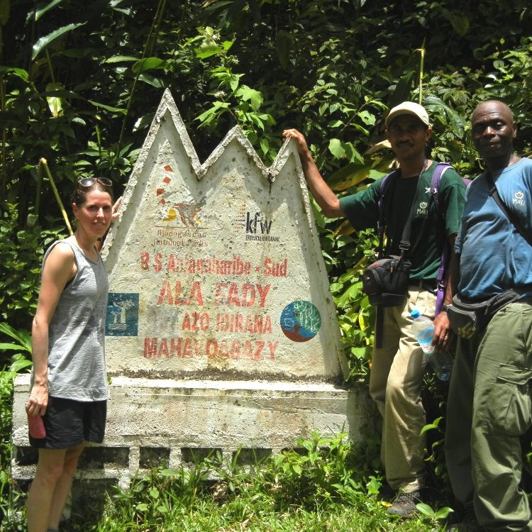 LCF staff standing at Anjanaharibe-Sud Special Reserve MNP sign in Madagascar