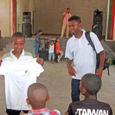 An Andapa World Lemur Festival proudly displays his LCF tee-shirt.