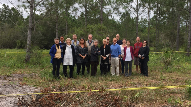 Board trustees and SAC scientists at the site of the new lemur shelter.