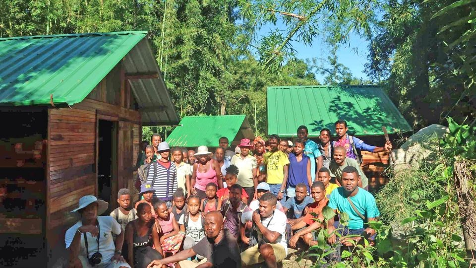 Malagasy community members who helped carry supplies